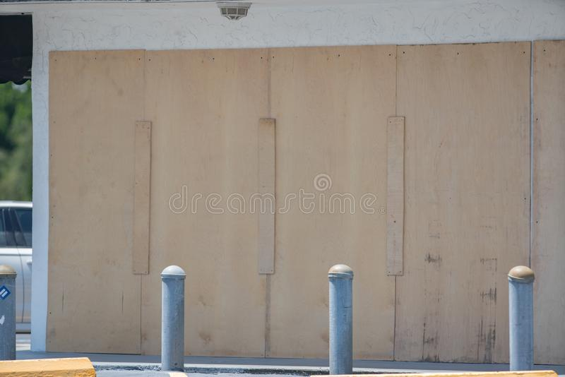 Hurricane shutters closed over a window in preparation for a hurricane storm. USA royalty free stock photos
