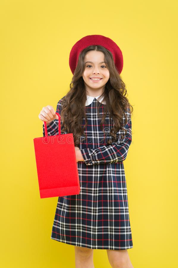 Hurry last chance because its sale. Cute small child smiling with purchase bought at sale on yellow background. Happy. Little girl holding shopping bag after royalty free stock photo