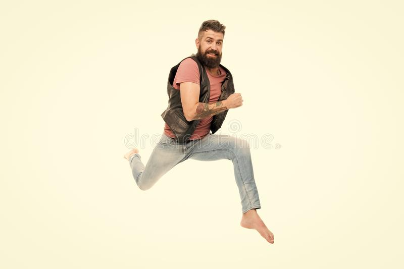 Hurry up. Guy happy cheerful face having fun run jumping. Life in motion. Man bearded guy run away. Always in motion. Last chance. Following his dream stock image