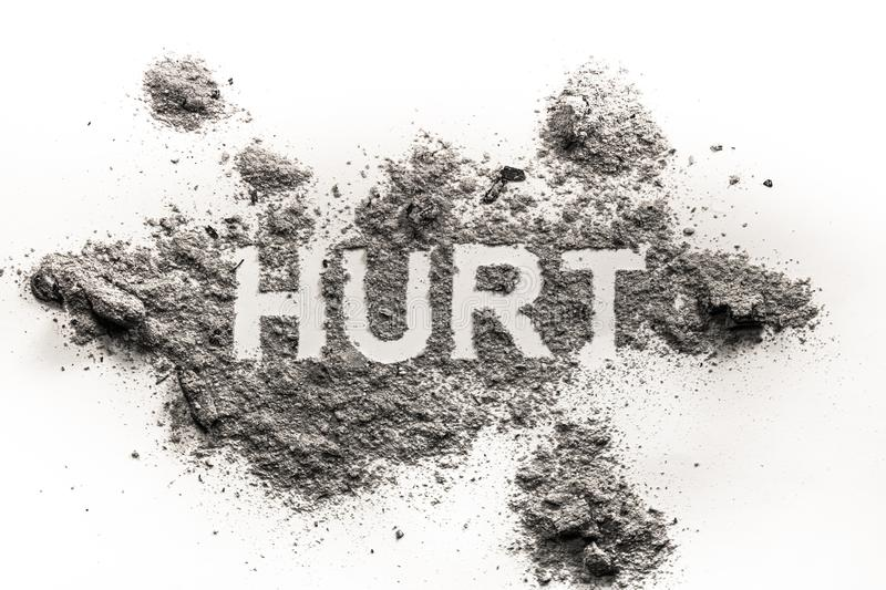 Hurt word as physical or emotional pain ache sickness. Health concept written in pile of dust ash sand royalty free stock images