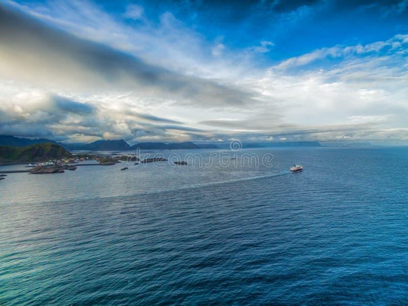 Hurtigruten from air. Aerial view of Hurtigruten sailing by the coast of Lofoten islands royalty free stock photography