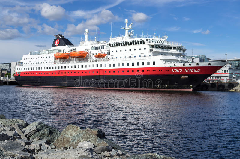 Hurtigruten coastal vessel KONG HARALD in Trondheim, Norway. Hurtigruten is a daily passenger and freight shipping service along Norway`s coast between Bergen stock photo