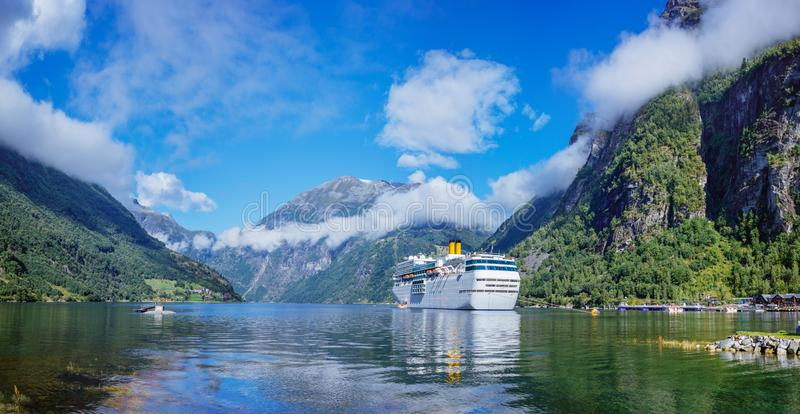 Hurtigruten cruise liner sailing on the Geirangerfjord, one of the most popular destination in Norway. And UNESCO World Heritage Site royalty free stock photo