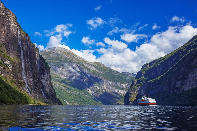 Hurtigruten cruise liner sailing on the Geirangerfjord, one of the most popular destination in Norway. And UNESCO World Heritage Site royalty free stock image