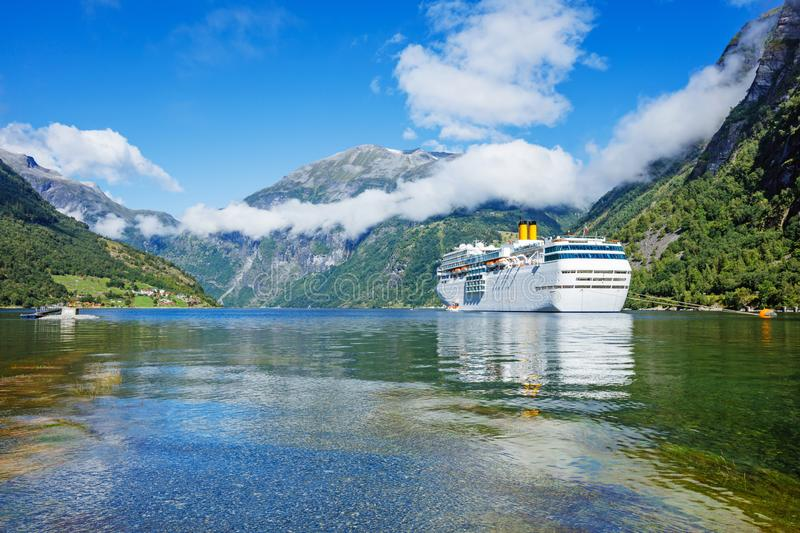 Hurtigruten cruise liner sailing on the Geirangerfjord, one of the most popular destination in Norway. And UNESCO World Heritage Site stock photo