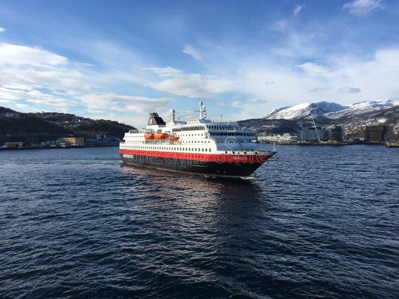Hurtigruten in Harstad, Norway. HARSTAD, NORWAY - APRIL 26, 2016 : The Hurtigruten ship MS Nordlys entering Harstad harbour. Hurtigruten is an Norwegian royalty free stock photos