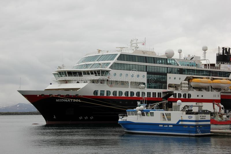 Hurtigruten Midnatsol. The Hurtigruten Midnatsol docked in the city of Honningsvag, Norway stock image