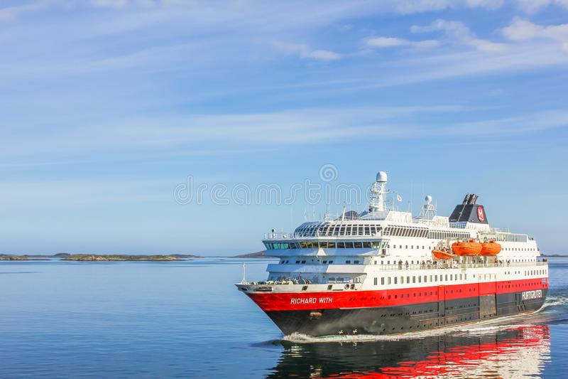 Hurtigruten MS Richard. Norway, Europe - May 4, 2011: Two Hurtigruten sail in Norwegian waters. Norwegian postal boat crosses MS Richard With, in Norwegian royalty free stock photo