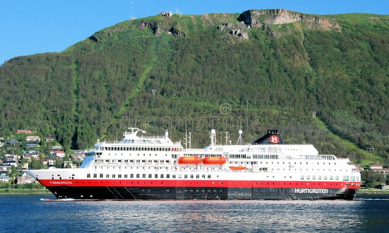 Hurtigruten - passenger and freight shipping -Norways coast. Hurtigruten - daily passenger and freight shipping - cruise service along Norways western and stock photo