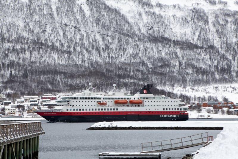 Hurtigruten ship entering Tromso harbour. Tromso, Norway - March 10, 2013 : Hurtigruten ship entering Tromso harbour . Hurtigruten is a Norwegian passenger and stock photos