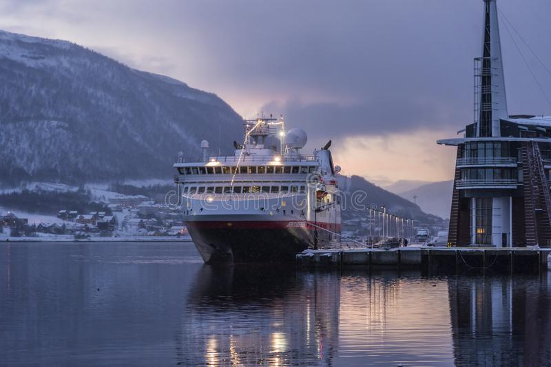 Hurtigruten ship M/S Spitsbergen moored Tromsø. Hurtigruten passenger ship M/S Spitsbergen moored at Dampskipskaia English: steamers quay in Tromsø. Light stock photo