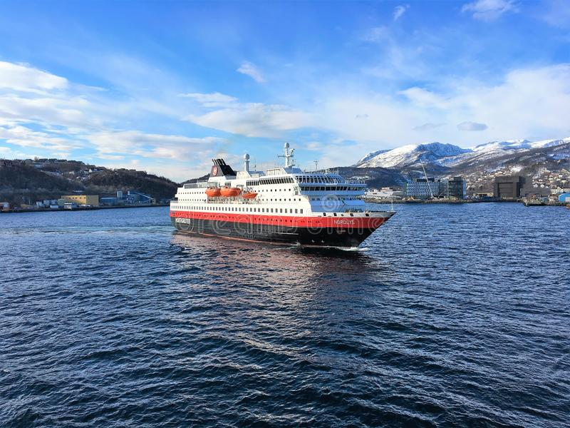 The Hurtigruten ship MS Nordlys entering Harstad harbour. HARSTAD, NORWAY - APRIL 26, 2016 : The Hurtigruten ship 'MS Nordlys' entering Harstad harbour royalty free stock photography