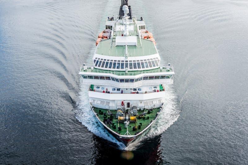 Hurtigruten shipping service in Norway. NORTH CAPE, NORWAY - JUNE 30, 2014: Hurtigruten, a daily passenger and freight shipping service along Norway's western royalty free stock image