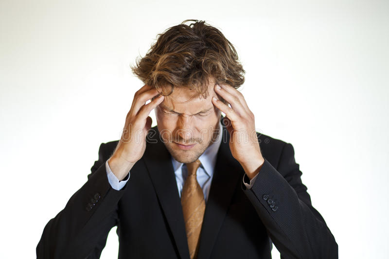 Hurting businessman with migraine stock photos