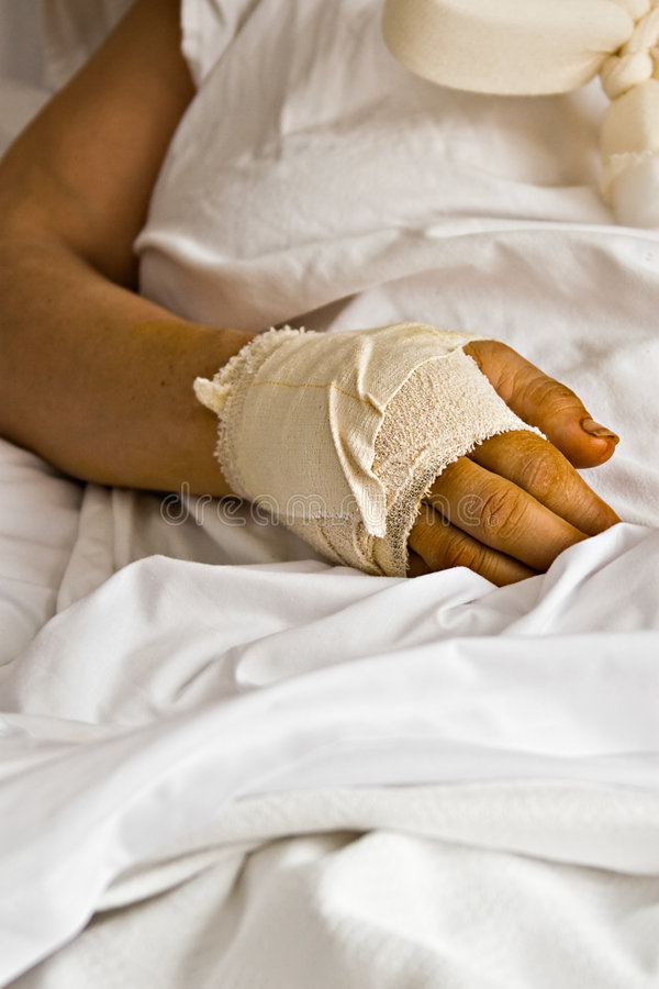 Hurting hand. Healthcare wounded hand, bandages, woman in the hospital, health series royalty free stock photo