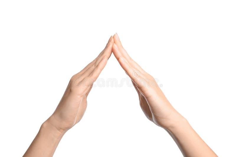 Hus för kvinnavisningord på vitt, closeup Teckenspråk arkivfoton