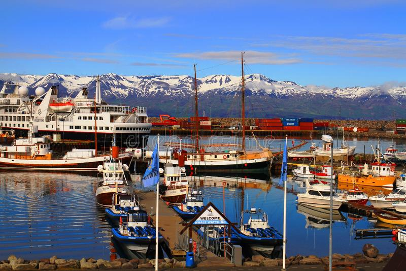 Husavik Harbor, July 2017, Iceland. Husavik is a popular starting point of whale watching tours stock image