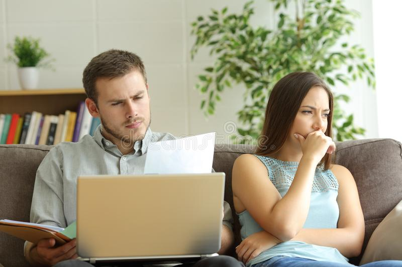 Husband addicted to work and unsatisfied wife stock photos