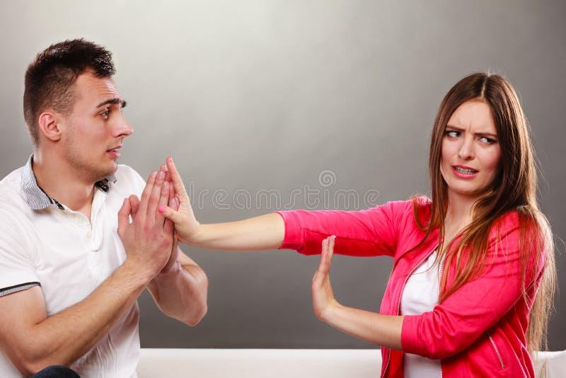 Husband apologizing wife. Angry upset woman. royalty free stock image