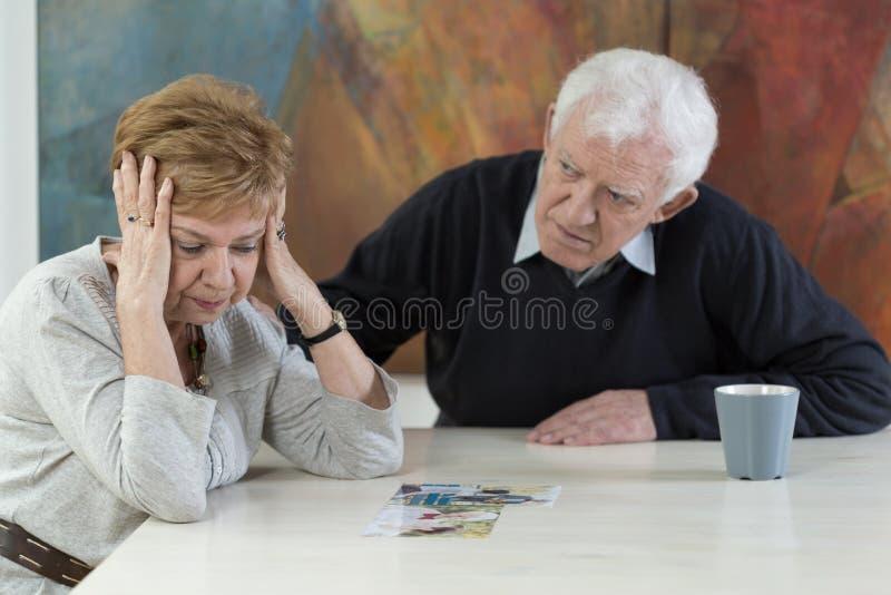 Husband betrayal. Senior women broken down because of her husband betrayal stock image