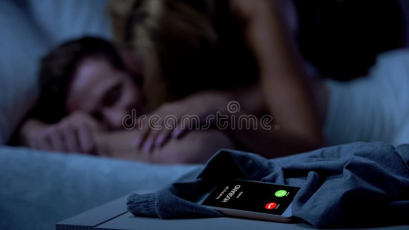 Husband calling, wife cheating with lover, broken relations betrayal, divorce. Stock photo stock images