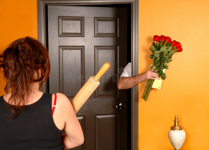 Husband coming home late to angry wife royalty free stock photo