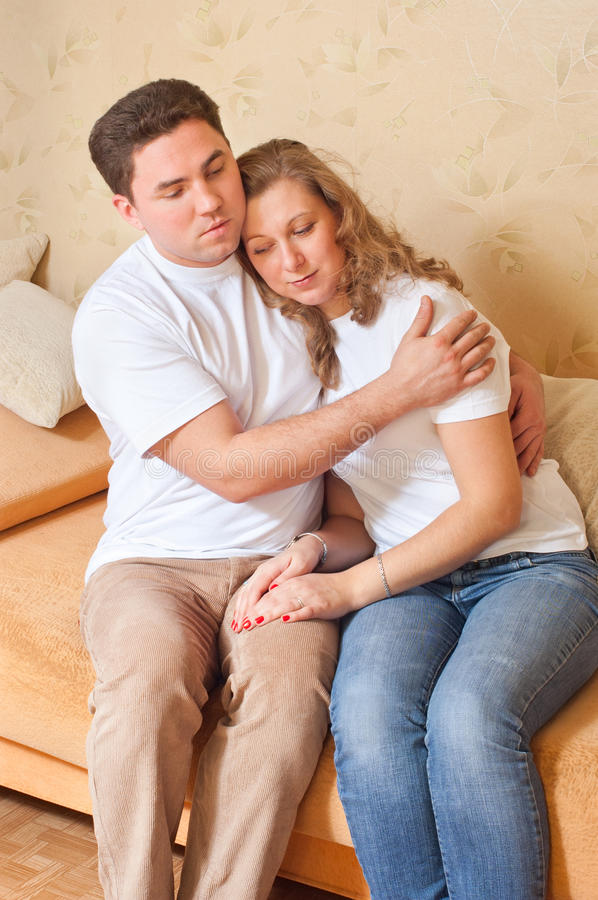 The husband feels sorry for the wife. An interior royalty free stock images