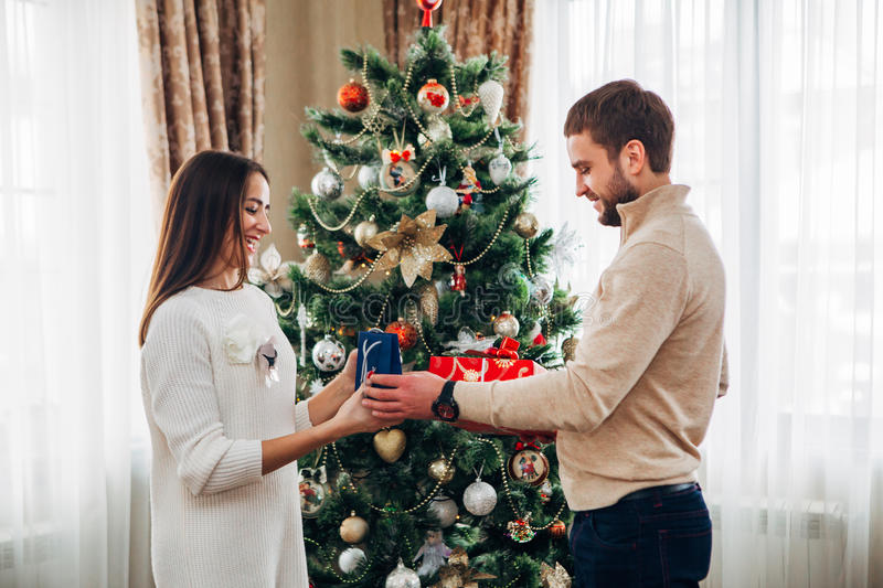 The husband gives Christmas gift to his wife royalty free stock photo