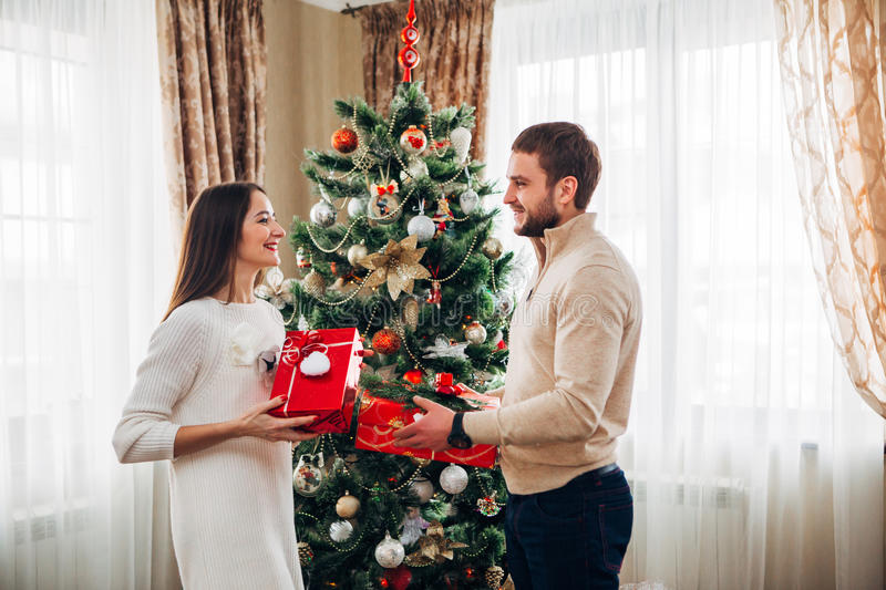 The husband gives Christmas gift to his wife royalty free stock photography