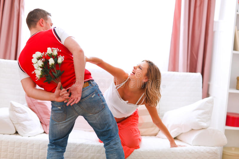 Download Husband Hiding Flowers From Pregnant Wife Stock Photo - Image: 22434180