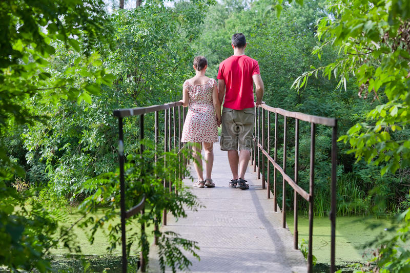 Husband With His Wife On The Bridge Stock Images