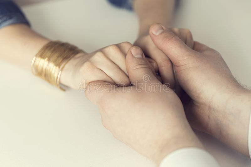 Husband holding hands of his wife. Mental support, marriage, couples concept royalty free stock photos