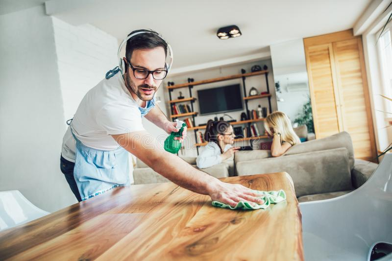 Husband housekeeping and cleaning concept. royalty free stock images