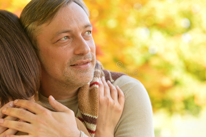 Husband hugging his wife royalty free stock images