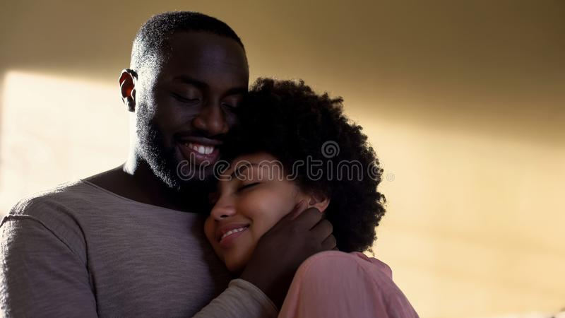 Husband hugging wife, family connection, harmonious relations, understanding royalty free stock photos