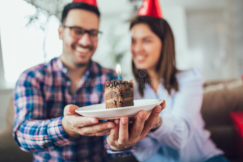 Wife surprise his husband with birthday cake.Anniversary. Husband`s birthday.Wife surprise his husband with birthday cake.Anniversary royalty free stock photos