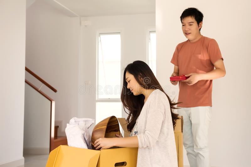 Husband with surprise gift to wife at new house royalty free stock image