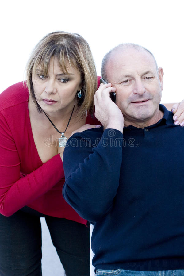 Husband talking on the phone and wife is listening royalty free stock photography