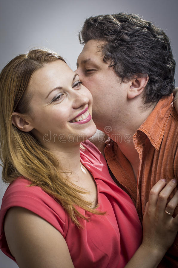 Download Husband Telling A Secret To His Wife Stock Photo - Image: 25835990