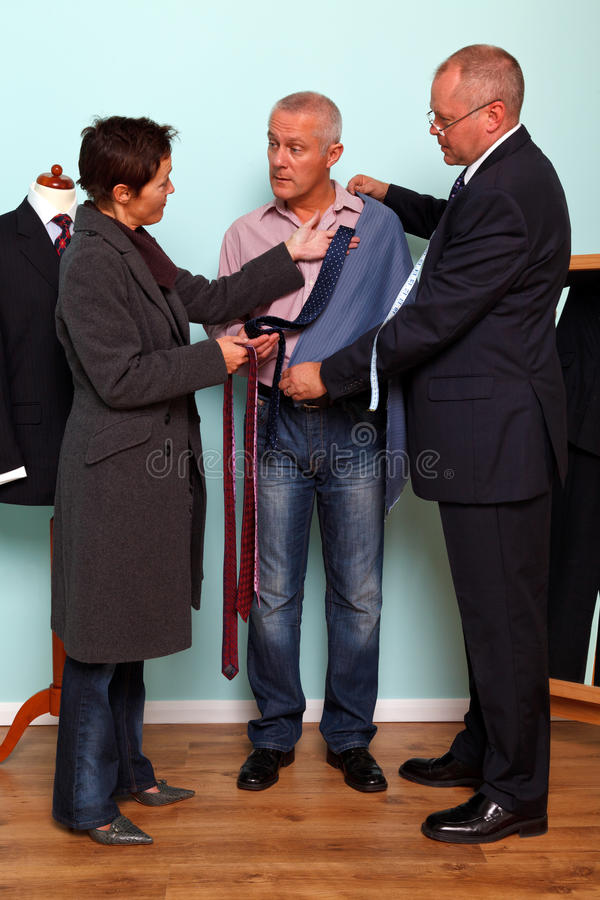 Husband and wife bespoke suit fitting royalty free stock photos