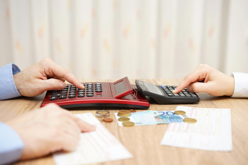 Husband and wife are calculating monthly expenses. tight budget royalty free stock image
