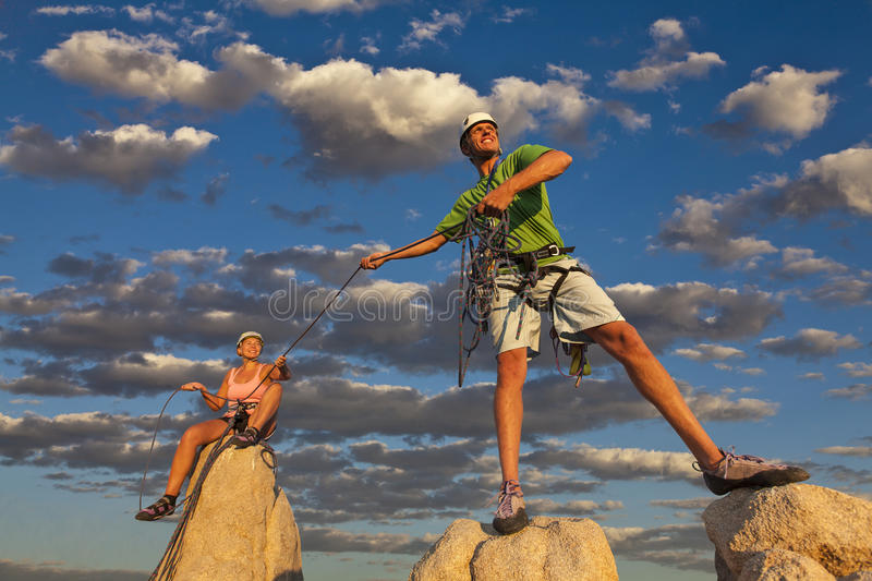 Husband and wife climbing team on the summit. stock images
