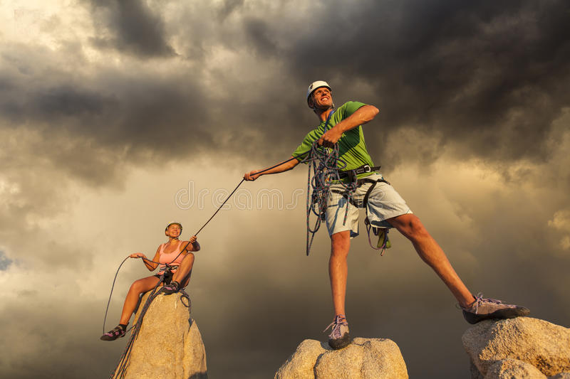 Husband and wife climbing team on the summit. royalty free stock photo