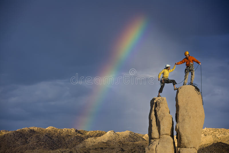 Husband and wife climbing team on the summit. royalty free stock image