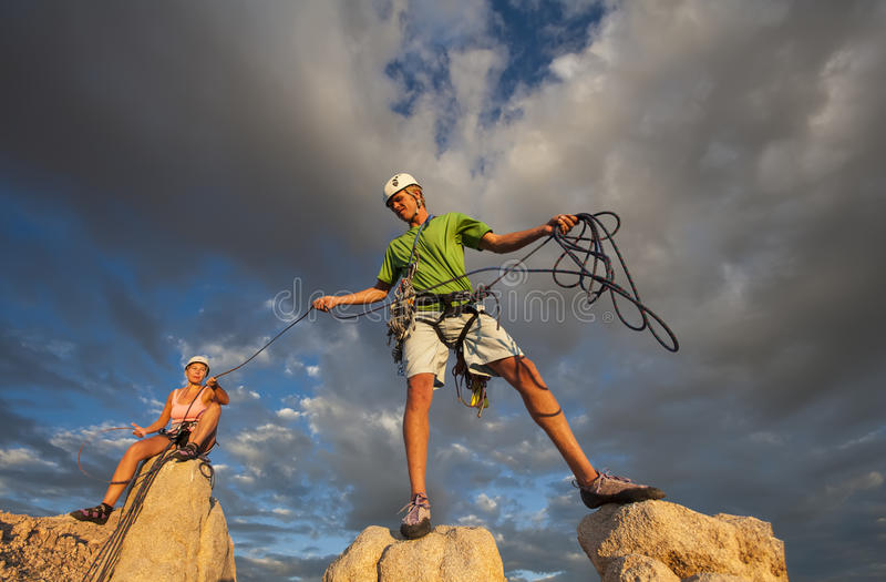 Husband and wife climbing team on the summit. stock photos
