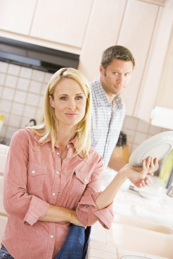 Husband And Wife Doing Dishes Stock Photography
