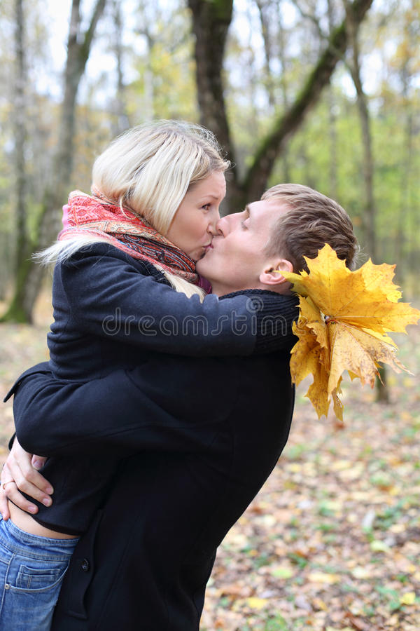 Download Husband And Wife Embrace And Kiss In Autumn Forest. Stock Photo - Image: 33462702