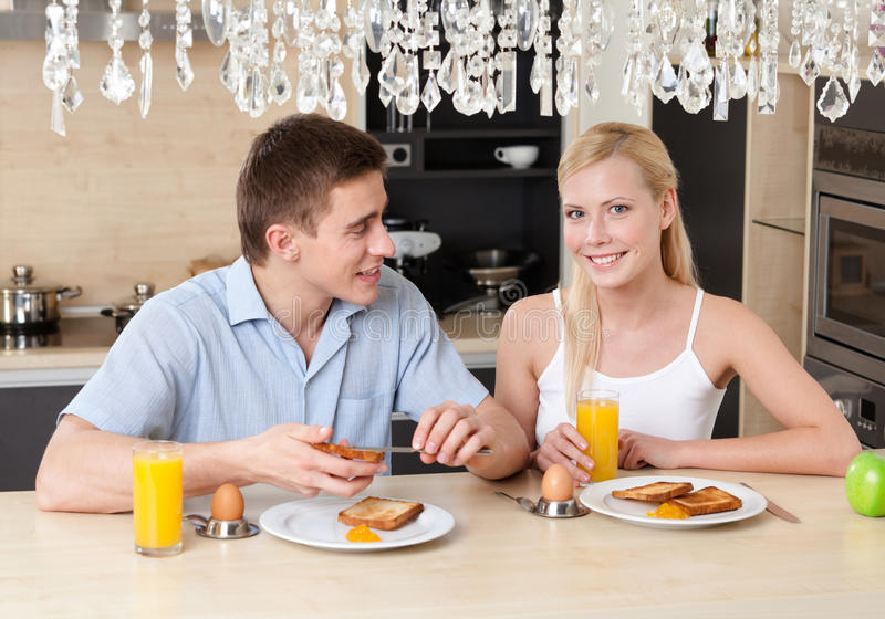 Download Husband And Wife Have Breakfast In The Kitchen Stock Photo - Image: 28729400