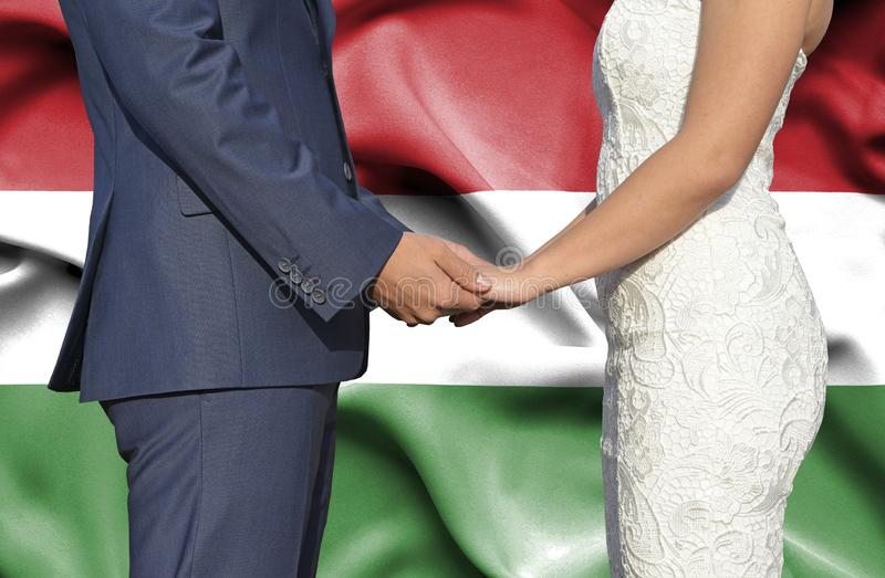 Husband and Wife holding hands - Conceptual photograph of marriage in Hungary royalty free stock photo