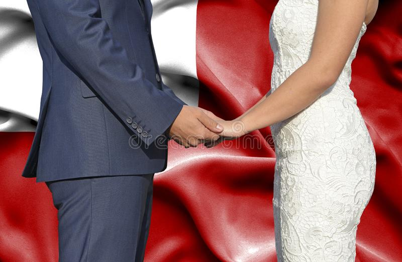 Husband and Wife holding hands - Conceptual photograph of marriage in Tonga royalty free stock image